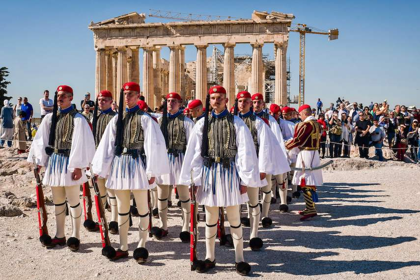TOPSHOT - Greek presidental Evzoni Guards stand in front the Parthenon temple atop the Acropolis hill during a ceremony marking the anniversary of the liberation of Athens from Nazi occupation, on October 12, 2017 in Athens. / AFP PHOTO / LOUISA GOULIAMAKI        (Photo credit should read LOUISA GOULIAMAKI/AFP/Getty Images)