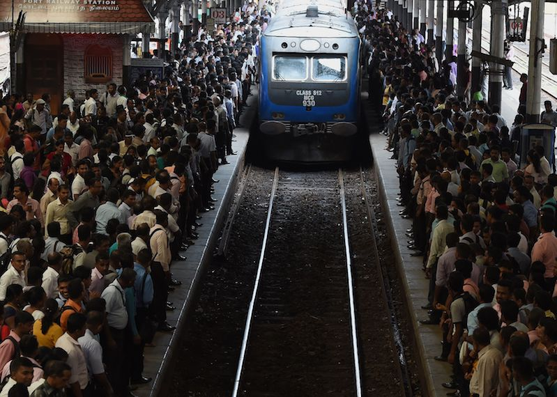TOPSHOT - Sri Lankan commuters board on a train at a railway station during a nationwide railway strike in Colombo on October 12, 2017.  Train engineers and conductors staged the strike demanding higher pay. / AFP PHOTO / ISHARA S. KODIKARA        (Photo credit should read ISHARA S. KODIKARA/AFP/Getty Images)