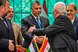 Fatah's Azzam al-Ahmad (right) and Saleh al-Aruri (left) of Hamas shake hands after signing a reconciliation deal in Cairo on Oct. 12. (Khaled Desouki/AFP/Getty Images)