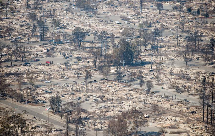 TOPSHOT - In this aerial view, burned properties are seen in Santa Rosa, California on October 12, 2017.  Hundreds of people are still missing in massive wildfires which have swept through California killing at least 26 people and damaging thousands of homes, businesses and other buildings. / AFP PHOTO / JOSH EDELSON        (Photo credit should read JOSH EDELSON/AFP/Getty Images)