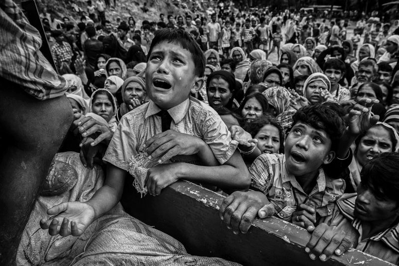 A distraught Rohingya boy seeks handouts near the Balukali refugee camp in Cox's Bazar, Bangladesh on Sept. 20. (Kevin Frayer/Getty Images)