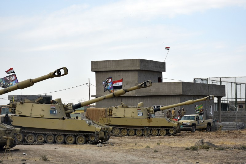 Iraq military vehicles parked outside of Kirkuk, Iraq, on Oct. 13. (Marwan Ibrahim/AFP/Getty Images)