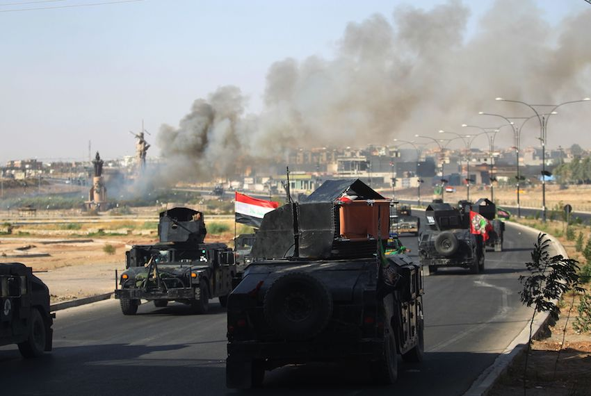 TOPSHOT - Smoke billows as Iraqi forces advance towards the centre of Kirkuk during an operation against Kurdish fighters on October 16, 2017.  Iraqi forces seized the Kirkuk governor's office, key military sites and an oil field as they swept across the disputed province following soaring tensions over an independence referendum. / AFP PHOTO / AHMAD AL-RUBAYE        (Photo credit should read AHMAD AL-RUBAYE/AFP/Getty Images)