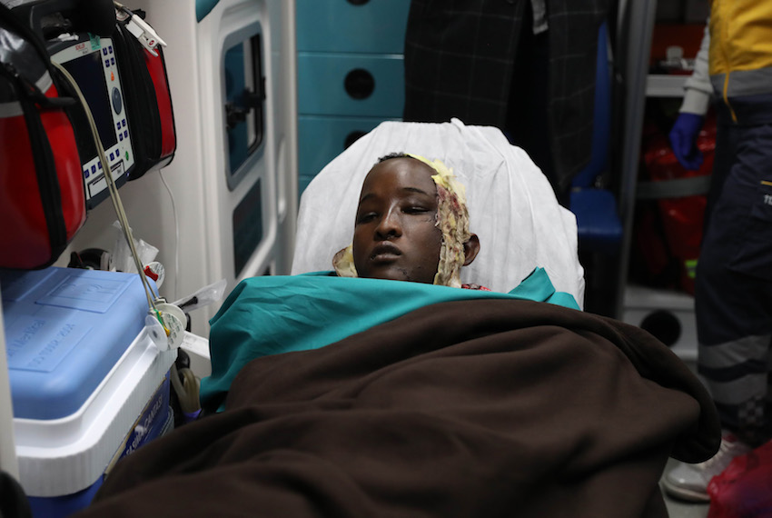 "TOPSHOT - A wounded boy from the latest explosion in Mogadishu is carried on a stretcher to receive treatment in a Turkish hospital, after a Turkish military plane, evacuating Somalians severely wounded, landed at the airport, in Ankara on October 16, 2017. Turkish President Recep Tayyip Erdogan's spokesman Ibrahim Kalin said Ankara was sending planes ""with medical supplies"", adding that the wounded would be flown to Turkey and treated there. / AFP PHOTO / ADEM ALTAN        (Photo credit should read ADEM ALTAN/AFP/Getty Images)"