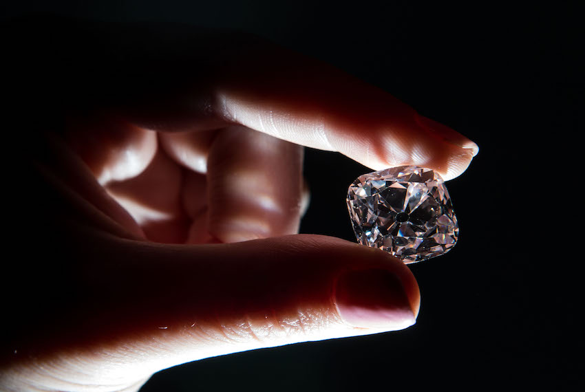 A woman poses with the 'Le Grand Mazarin', a 19.07 carat pink diamond, at Christie's auction house in London on October 17, 2017.  'Le Grand Mazarin' is estimated to reach 6-9 million dollars on auction in Geneva on November 14, 2017.  / AFP PHOTO / CHRIS J RATCLIFFE        (Photo credit should read CHRIS J RATCLIFFE/AFP/Getty Images)