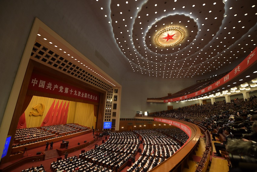 TOPSHOT - A general view shows delegates attending the opening of the 19th Communist Party Congress at the Great Hall of the People in Beijing on October 18, 2017. The Chinese Communist Party opens its week-long, twice-a-decade congress in the Great Hall of the People. / AFP PHOTO / NICOLAS ASFOURI        (Photo credit should read NICOLAS ASFOURI/AFP/Getty Images)