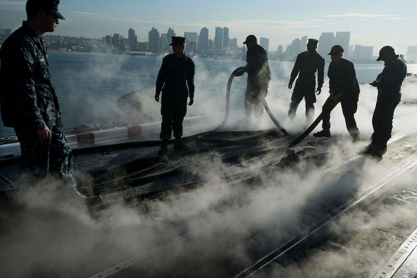 SAN DIEGO, CA - OCTOBER 18: Navy Sailors prepare the flight deck during training exercises aboard the USS Carl Vinson on October 18, 2017 in San Diego, California. The Navy will soon conduct exercises with the new F-35 C Striker Jet as well as train for combat missions. (Photo by Sandy Huffaker/Getty Images)
