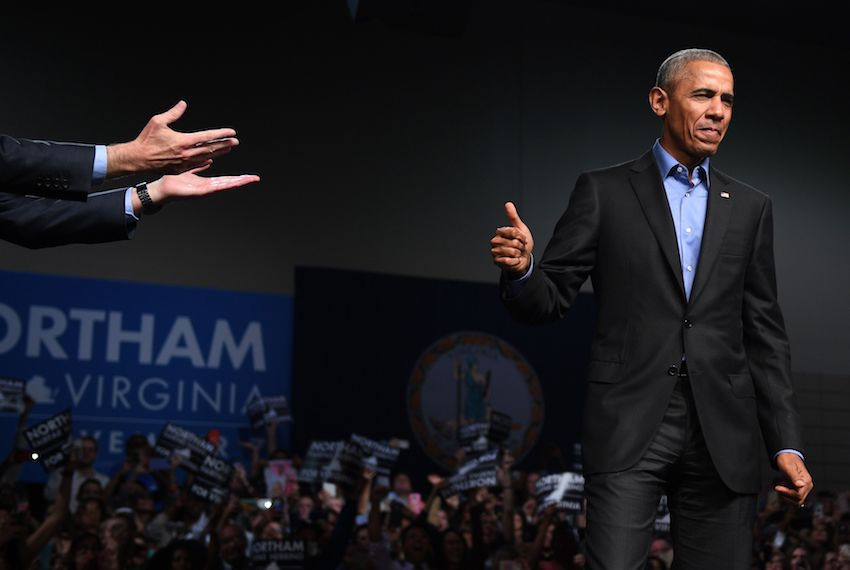 TOPSHOT - Former US President Barack Obama (R) gestures to Democratic Gubernatorial Candidate Ralph Northam during a campaign rally in Richmond, Virginia October 19, 2017. / AFP PHOTO / JIM WATSON        (Photo credit should read JIM WATSON/AFP/Getty Images)