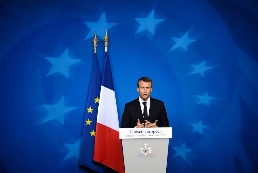 TOPSHOT - French President Emmanuel Macron speaks to the press at the end of the EU leaders' summit at the building Council of the EU, in Brussels on October 20, 2017. EU leaders agreed to start internal work on the bloc's relationship with Britain after Brexit, giving some progress for embattled Prime Minister Theresa May to take back home. / AFP PHOTO / JOHN THYS        (Photo credit should read JOHN THYS/AFP/Getty Images)