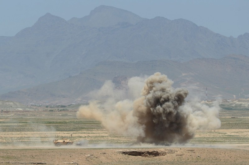 The Afghan army conducts a controlled explosion during a military exercise on the outskirts of Kabul on April 30, 2014. (Shah Marai/AFP/Getty Images)