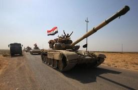 Iraqi forces drive towards Kurdish Peshmerga positions on Oct. 15 on the southern outskirts of Kirkuk. (Ahmad al-Rubaye/AFP/Getty Images)