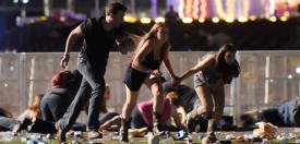 People run from the Route 91 Harvest country music festival  on October 1, 2017 in Las Vegas, Nevada. A gunman opened fire on a music festival in Las Vegas, leaving at least 59 people dead and more than 500 injured. (David Becker/Getty Images)