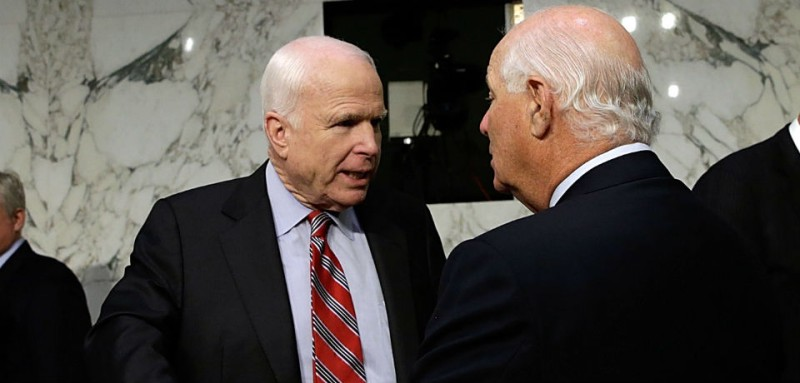 John McCain and Ben Cardin confer in Sept. 2013. (Win McNamee/Getty Images)