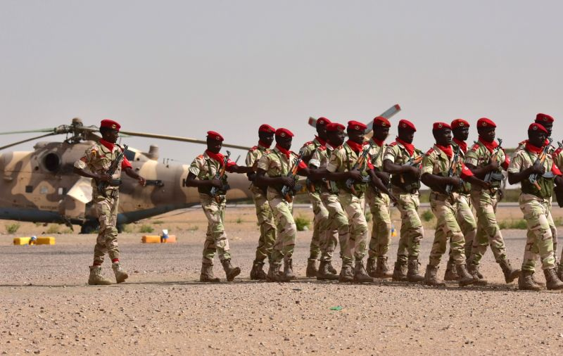 Soldiers from Niger's National Guard march on the tarmac in Diffa, southeastern Niger, on June 16, 2016. (Issouf Sanogo/AFP/Getty Images)