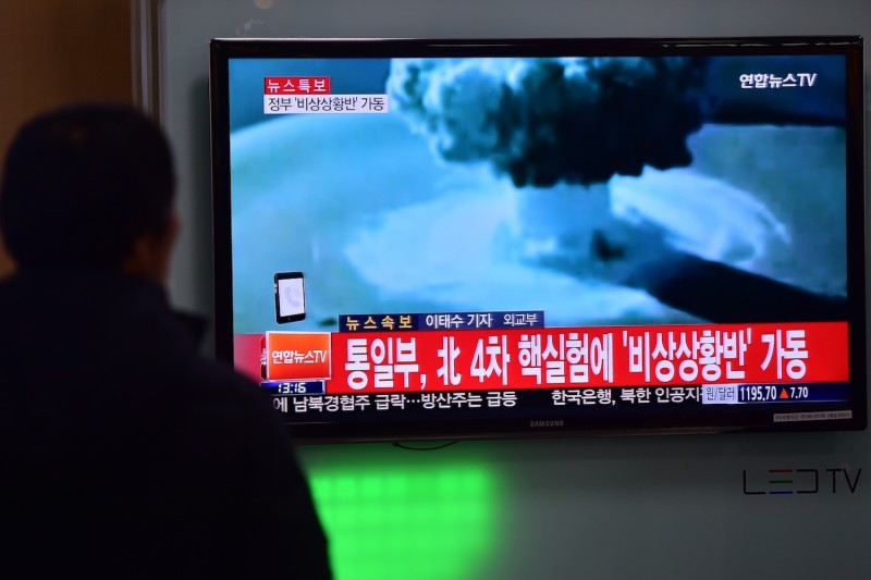 People watch a news report in Seoul on North Korea's first hydrogen bomb test on Jan. 6, 2016. (Jung Yeon-Je/AFP/Getty Images)