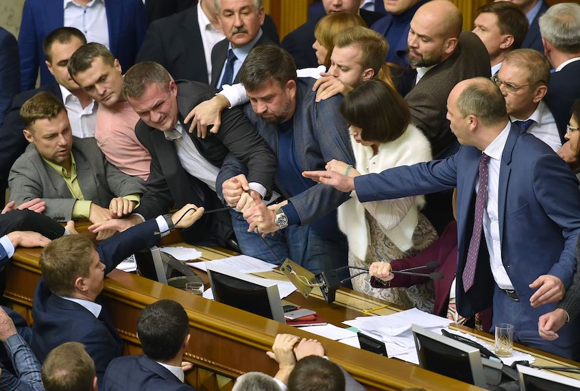 Ukrainian MPs fight in Kiev on October 5, 2017. The Ukrainian parliament launched on October 5 a hearing on a draft law 'On the specifics of the state policy to ensure the state sovereignty of Ukraine over the temporarily occupied territories in the Donetsk and Lugansk regions' that sparked tensions between the different factions of the legislature. (GENYA SAVILOV/AFP/Getty Images)