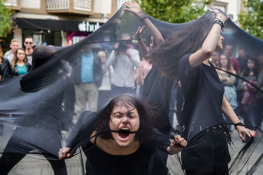 Women engage in a street performance in Pristina on October 6, to advocate against sexual harassment in Kosovo.  ( ARMEND NIMANI/AFP/Getty Images)