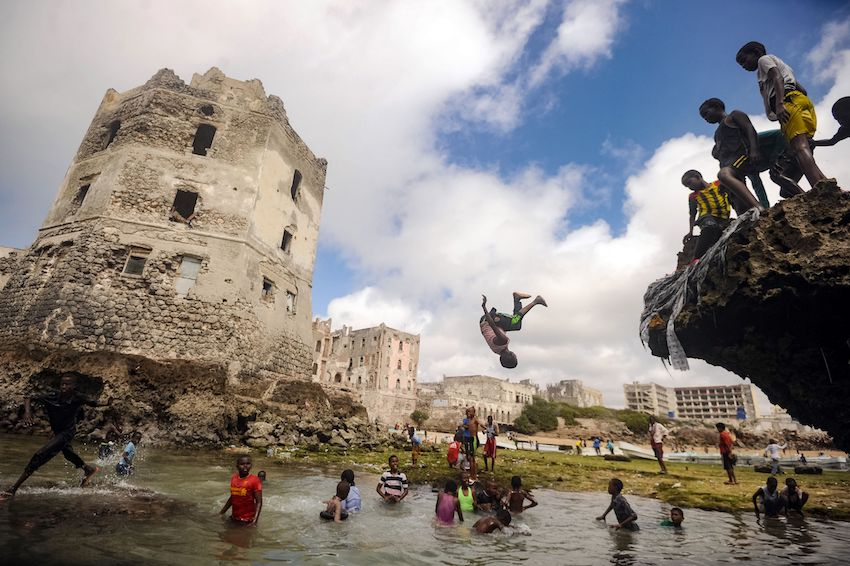 Somali children play in front of the ruins of an old building on the seashore of Hamarweyne district in Mogadishu, on October 6. (MOHAMED ABDIWAHAB/AFP/Getty Images)