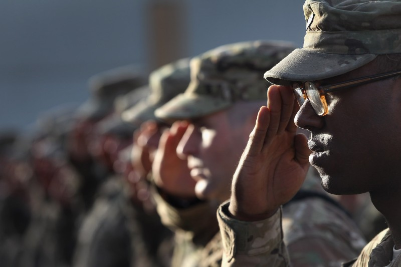 U.S. Army soldiers salute during an anniversary ceremony of the 9/11 terrorist attacks on Sept. 11, 2011 at Bagram Air Field, Afghanistan. (John Moore/Getty Images)