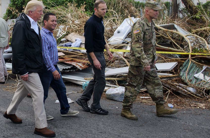 U.S. President Donald Trump visits residents affected by Hurricane Maria in Guaynabo, Puerto Rico on October 3.        (MANDEL NGAN/AFP/Getty Images)