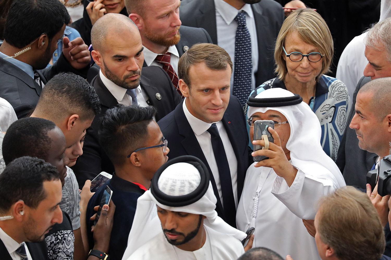French President Emmanuel Macron visits the Paris-Sorbonne University Abu Dhabi on Nov. 9.(Ludovic Marin/AFP/Getty Images)