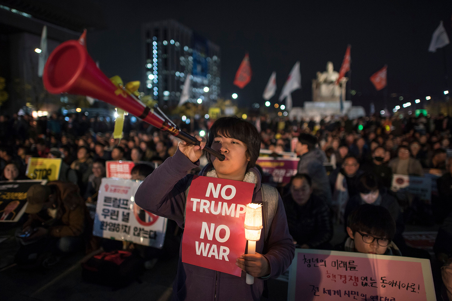 Protesters against US President Donald Trump gather during a rally in the Gwanghwamun area of central Seoul on Nov. 7. Ed Jones/AFP/Getty Images