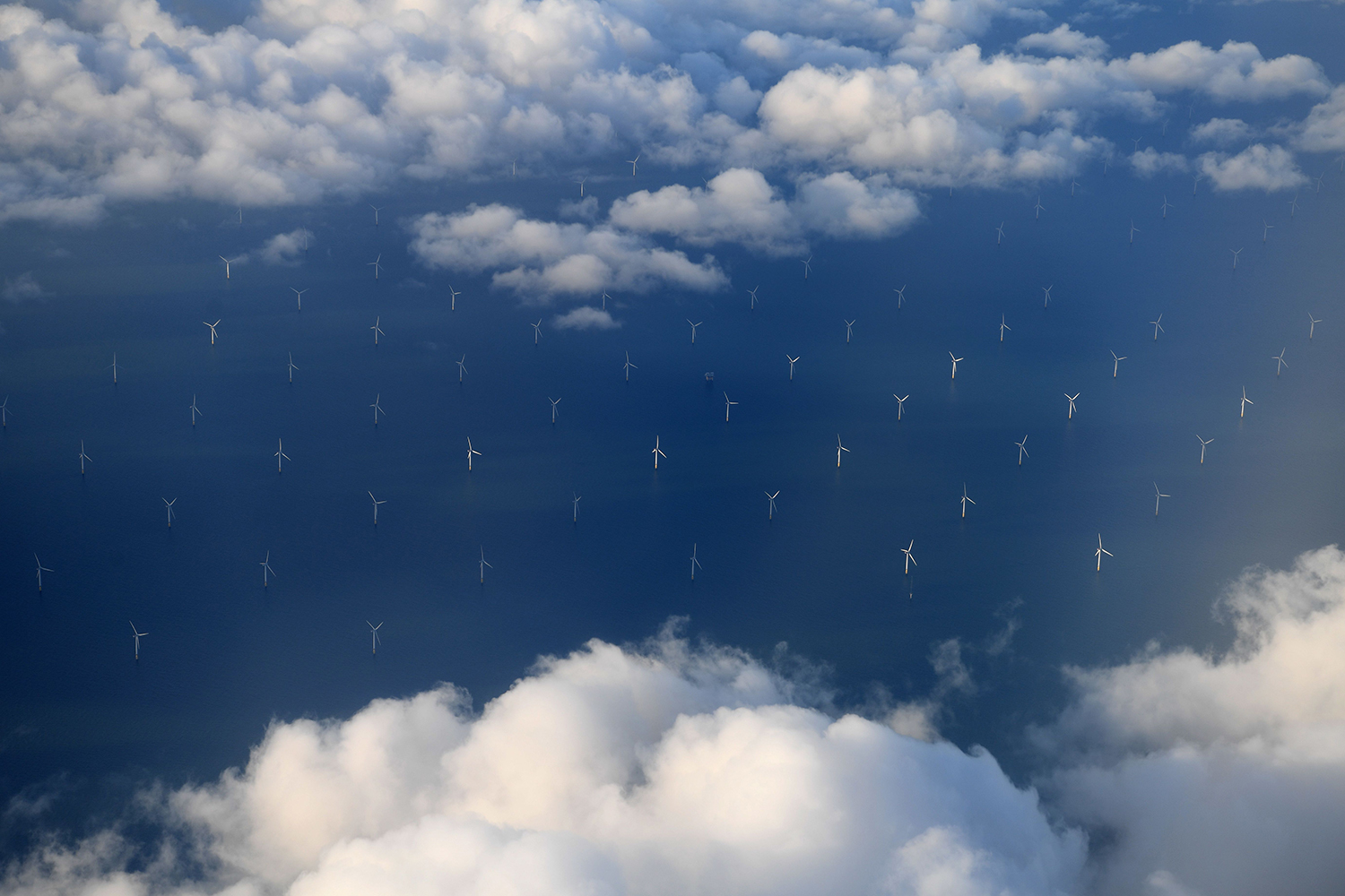 Burbo Bank Offshore Wind Farm on the Burbo Flats in Liverpool Bay, operated by DONG Energy, is pictured from the the window of an aircraft flying over the Irish Sea, off the west coast of northern England, on November 8, 2017.       (Paul Ellis/AFP/Getty Images)