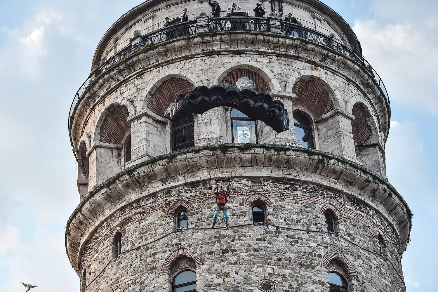 Turkish extreme sports athlete Cengiz Kocak performs a base jump off Galata Tower in Istanbul on Nov. 2017, as part of the events organized by European Outdoor Film Tour (EOFT) in Istanbul. Ozan Kose/AFP/Getty Images