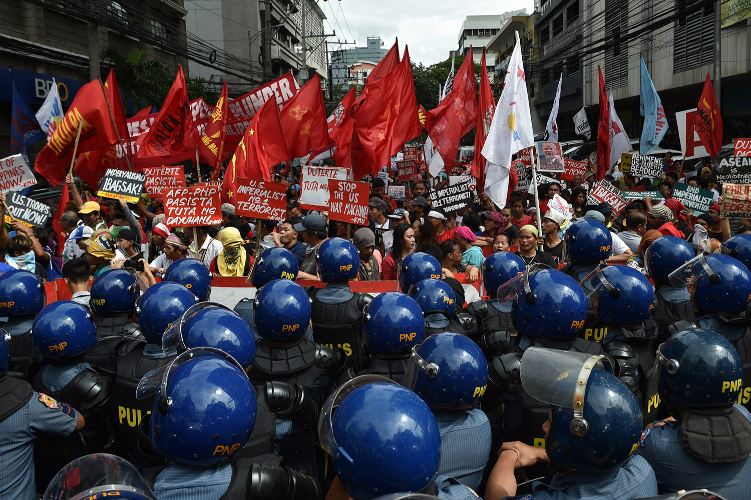 Riot police block protesters during a rally near the U.S. embassy, ahead of the 31st Southeast Asian Nations (ASEAN) Summit, in Manila on Nov. 10. Ted Aljibe/AFP/Getty Images