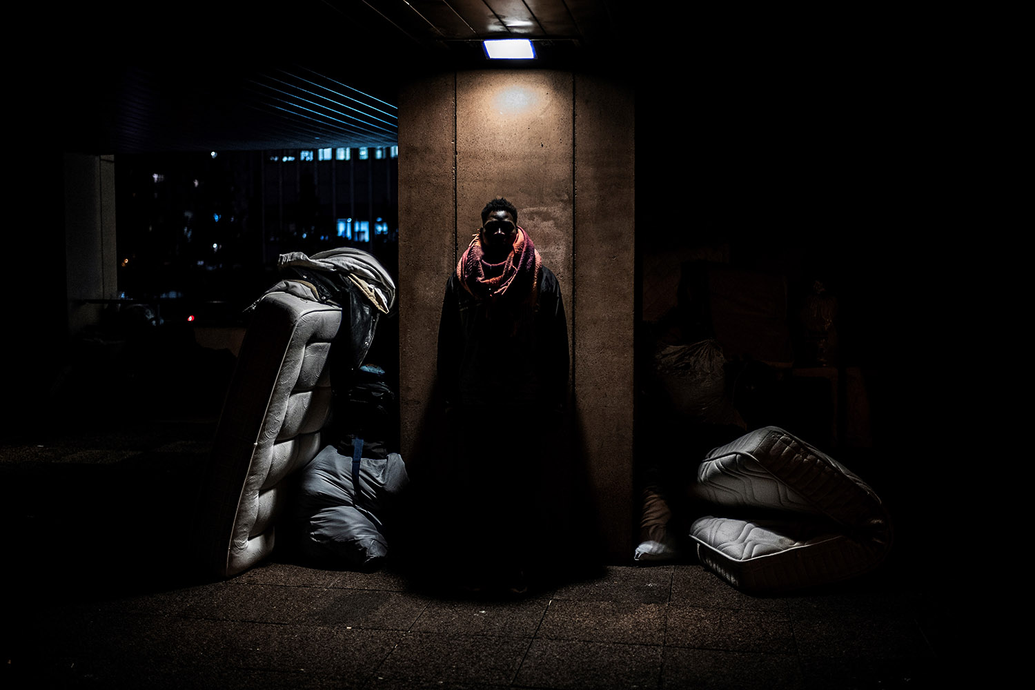 A minor poses in a makeshift camp where he sleeps on Nov. 7 in Lyon.        Jeff Pachoud/AFP/Getty Images