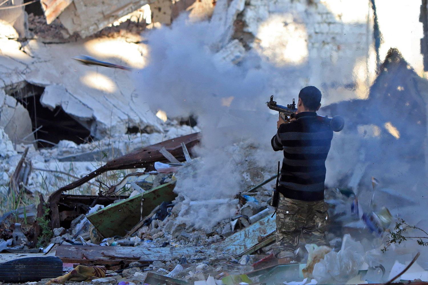 A member of the self-styled Libyan National Army, loyal to the country's east strongman Khalifa Haftar, fires a rocket propelled grenade (RPG) during clashes with militants in Benghazi's central Akhribish district on Nov. 9. Abdullah Doma /AFP/Getty Images