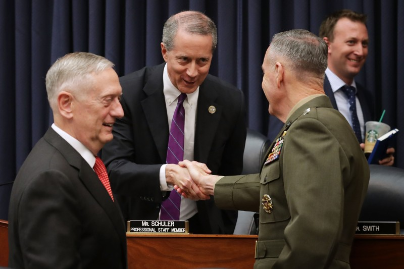 Defense Secretary James Mattis and Chairman of the Joint Chiefs Gen. Joseph Dunford greet House Armed Services Committee Chairman Mac Thornberry (R-TX) on June 12, 2017. (Chip Somodevilla/Getty Images)