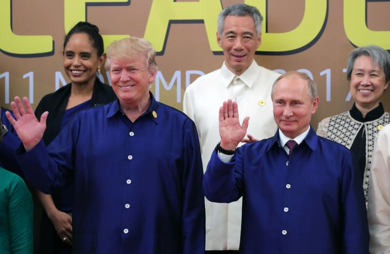 President Donald Trump and Russian President Vladimir Putin wave at the Asia-Pacific Economic Cooperation Summit in Vietnam on November 10. (Mikhail  Klimentyev/AFP/Getty Images)