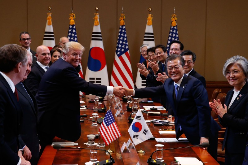 South Korean President Moon Jae-In shakes hands with President Donald Trump during their summit in Seoul on November 7. (Jeon Heon-Kyun - Pool /Getty Images)