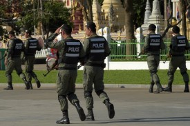 Cambodian police officials patrol during a hearing at the Supreme Court in Phnom Penh on Nov. 16. (Tang Chhin Sothy/AFP/Getty Images)