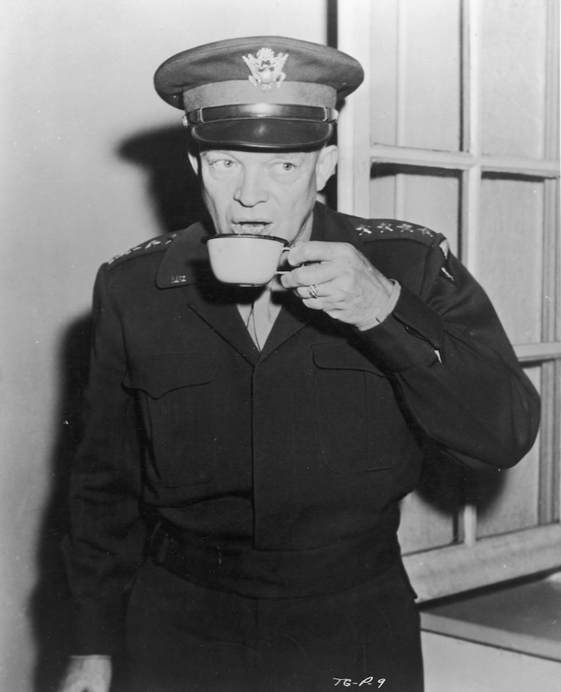 Commanding General of U.S. Army Europe, Dwight D. Eisenhower (1890 - 1969) drinks a cup of coffee at Allied Headquarters in Paris, in a scene from the World War II documentary 'The True Glory', directed by Garson Kanin and Carol Reed, circa 1945. (FPG/Archive Photos/Getty Images)