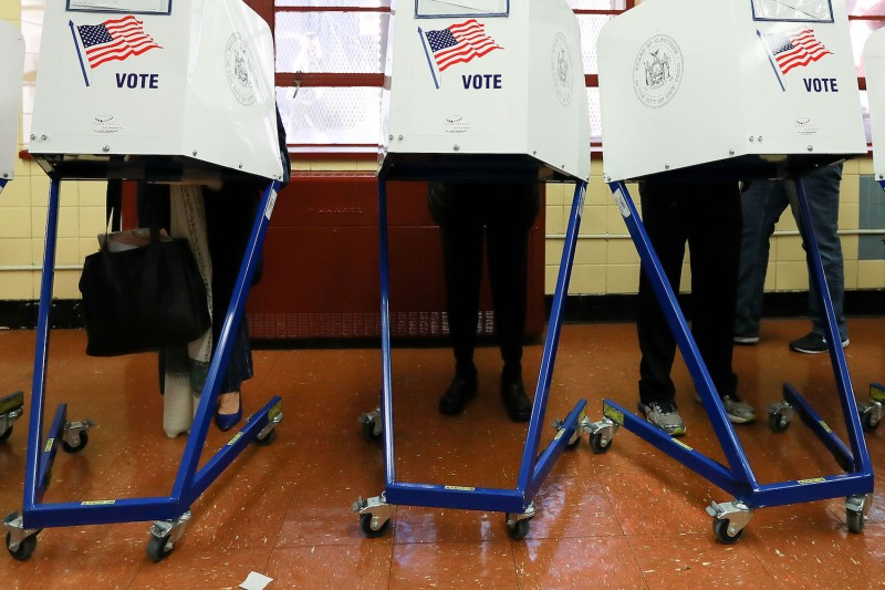 Voters cast their ballots at voting booths at PS198M The Straus School on Nov. 8, 2016 in New York City, New York. (Michael Reaves/Getty Images)