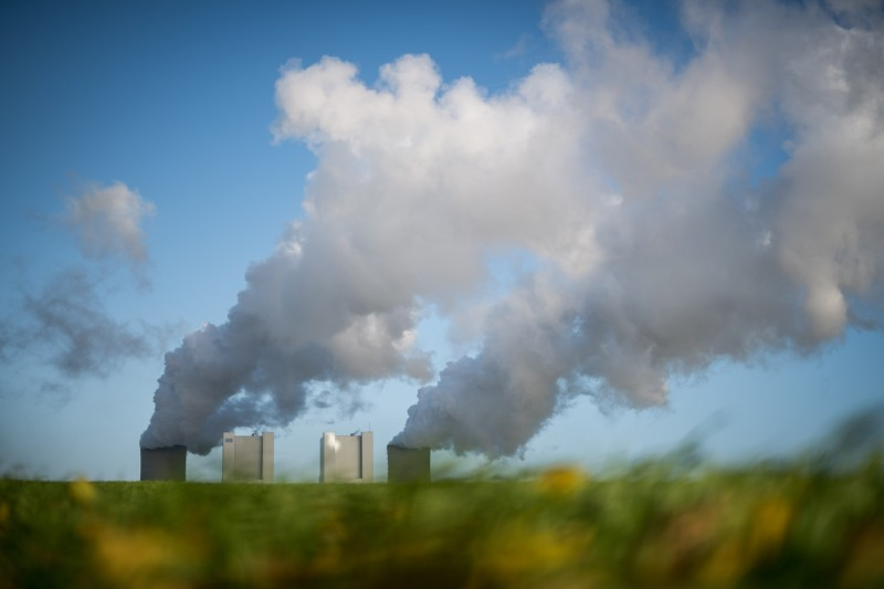 Steam rises from the Neurath coal-fired power plant operated by German utility RWE, which stands near open-pit coal mines that feed it with coal, on Nov. 13, near Bergheim, Germany. (Lukas Schulze/Getty Images)