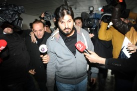 Reza Zarrab is surrounded by journalists as he arrives at a police station in Istanbul on Dec. 17, 2013. (OZAN KOSE/AFP/Getty Images)