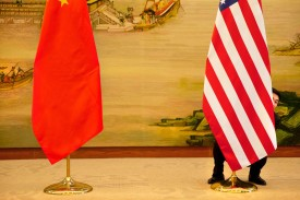 A U.S. flag is adjusted ahead of a news conference between U.S. Secretary of State John Kerry and Chinese Foreign Minister Wang Yi at the Ministry of Foreign Affairs in Beijing on Jan. 27, 2016. (Jacquelyn Martin/AFP/Getty Images)