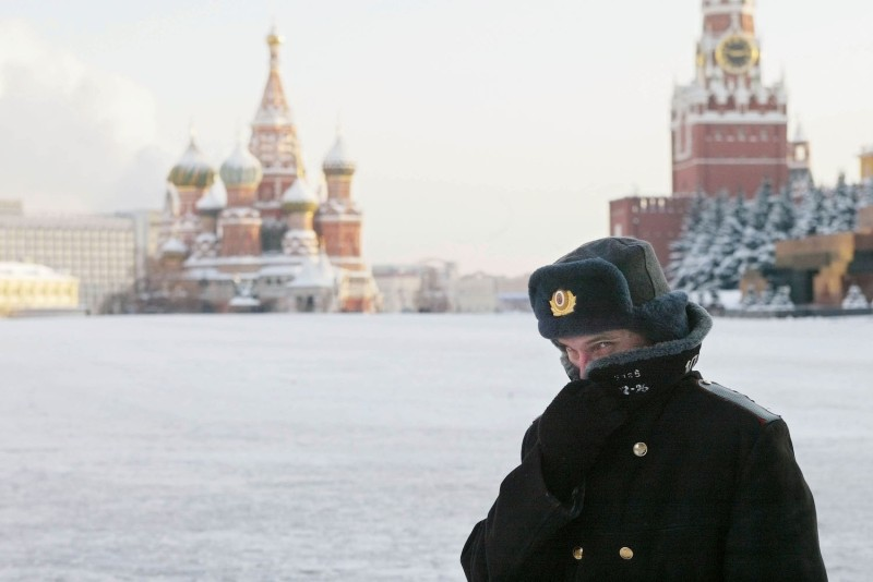 A Russian police officer in Moscow patrols Red Square with the Kremlin in the background on Jan. 7, 2003. (Oleg Nikishin/Getty Images)