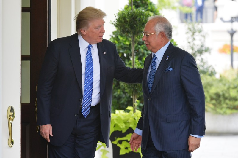 President Donald Trump greets Malaysian Prime Minister Najib Razak outside of the West Wing of the White House on Sept. 12. (Mandel Ngan/AFP/Getty Images)