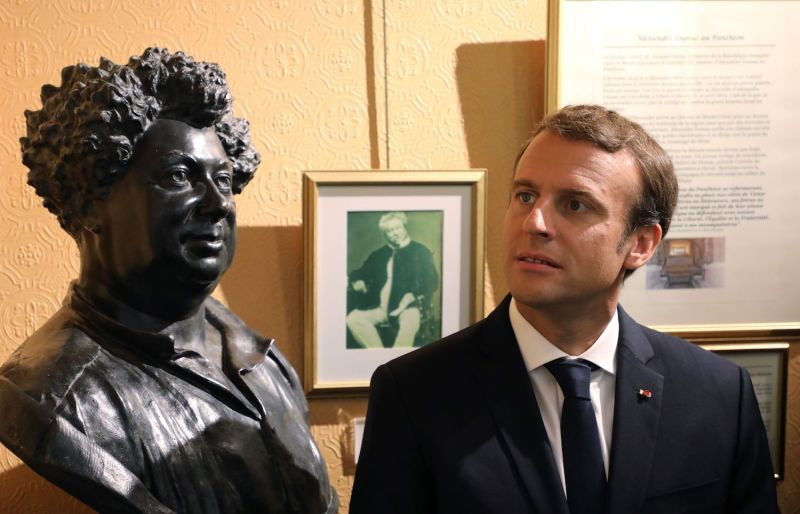 French President Emmanuel Macron looks at a bust of writer Alexandre Dumas during a visit to the Monte Cristo castle near Paris, on Sep. 16. (Ludovic Marin/AFP/Getty Images)