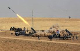 Iraqi security forces launch a rocket toward Kurdish Peshmerga positions near Fishkhabour. (Ahmad al-Rubaye/AFP/Getty Images)