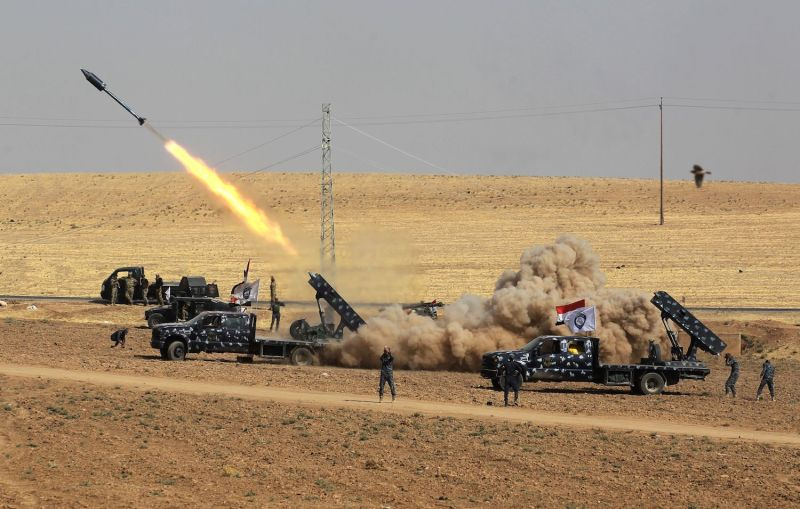 Iraqi security forces launch a rocket toward Kurdish Peshmerga positions near Fishkhabour. (Ahmad al-Rubaye/AFP/Getty Images)