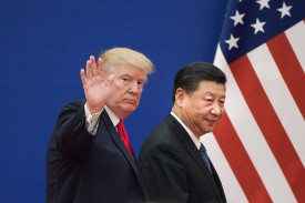U.S. President Donald Trump and Chinese President Xi Jinping leave a business leaders event in Beijing on Nov. 9. (Nicolas Asfouri/AFP/Getty Images)