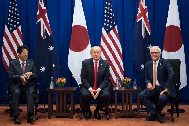 Japanese Prime Minister Shinzo Abe, U.S. President Donald Trump and Australian Prime Minister Malcolm Turnbull during the South East Asian Nations (ASEAN) summit in Manila on Nov. 13. (Jim Watson/AFP/Getty Images)