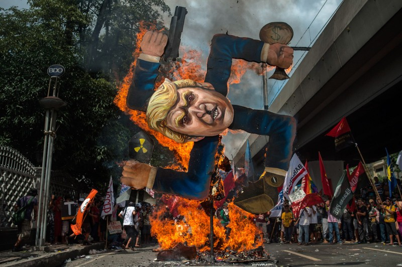 Protesters burn an image of U.S. President Donald Trump fashioned on a swastika as they march the streets of Manila during the start of the ASEAN meetings between heads of state on Nov. 13 in Manila, Philippines. (Jes Aznar/Getty Images)