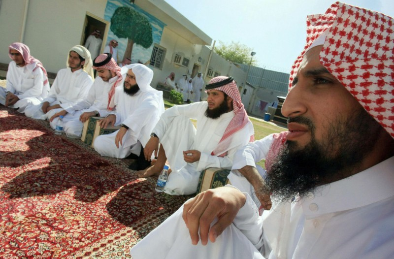 Young Saudi men listen to a Muslim cleric during a religious course at an Interior Ministry rehabilitation center 50 miles north of Riyadh on Nov. 3, 2007. (Hassan Ammar / Stringer)