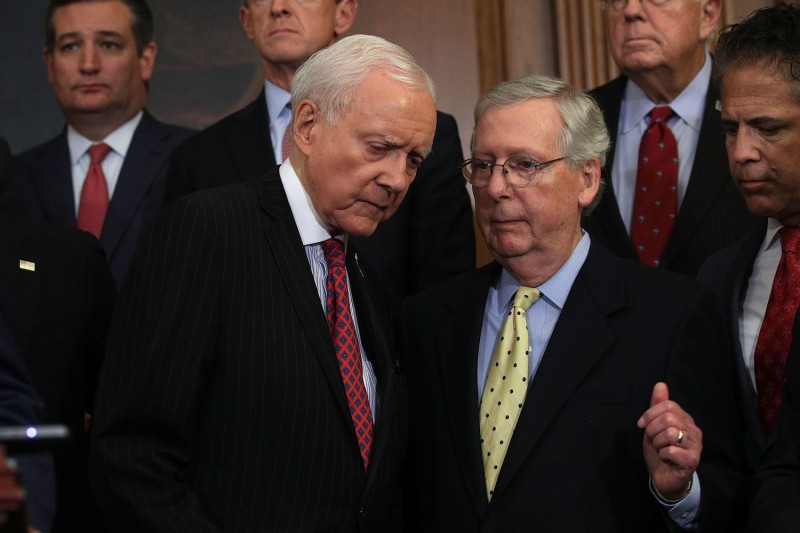 U.S. Senate Majority Leader Sen. Mitch McConnell (R-KY) (right) talks with Sen. Orrin Hatch (R-UT) as they attend a press event on tax reform on Sept. 27, at the Capitol in Washington, D.C. (Alex Wong/Getty Images)